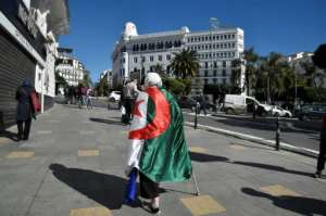 Friday's protest is the first major test of whether Algeria's president has calmed public anger with his vow not to seek re-election.  By RYAD KRAMDI (AFP)