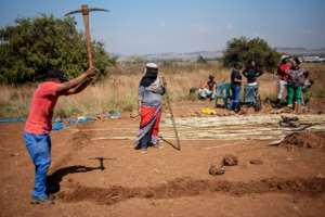 Frustrated by their chronic housing problems, members of the 'Coloured' community seize a plot of land in Eldorado Park, marking out where they hope to build new homes. By Michele Spatari (AFP)
