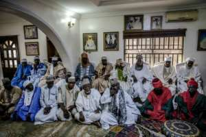 Fulani men at the gathering at the Sarkin Fulani's palace in Lagos' Surulere district. The Fulani have a proud tradition as cattle herders but most of the men are urban.  By Luis TATO (AFP)