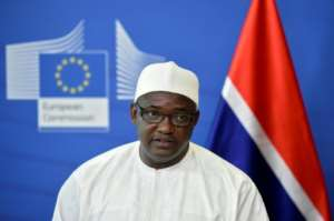 Gambian president Adama Barrow met with the families of three young protesters killed at an anti-pollution rally.  By JOHN THYS (AFP)