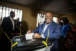 Gabonese President Ali Bongo casts his vote at a polling station in Libreville during the presidential election on August 27, 2016