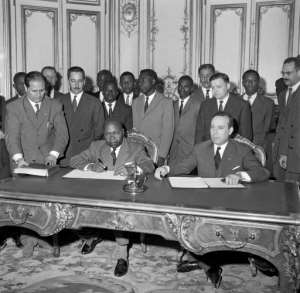 Gabonese Prime minister Leon M'ba and French Prime minister Michel Debre sign an agreement between France and Gabon in 1960.  By  (AFP/File)
