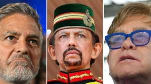 George Clooney and Elton John are among those who have criticsed the new laws being introduced by the Sultan of Brunei Hassanal Bolkiah (C). By Valerie MACON, Karen BLEIER (AFP/File)