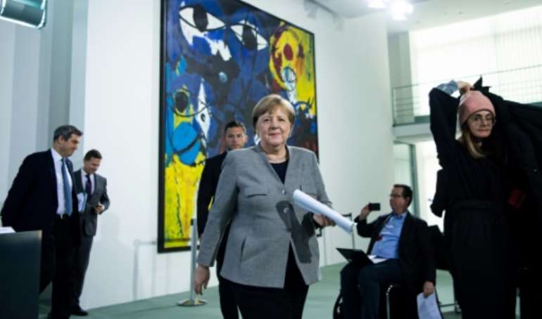 German Chancellor Angela Merkel announced plans to lift some of the restrictions imposed because of the coronavirus pandemic.  By Bernd von Jutrczenka (POOL/AFP)