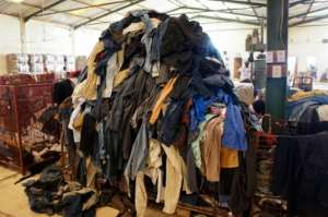 Get it sorted: Second-hand clothes at Le Relais' warehouse.  By Mariama DARAME (AFP)