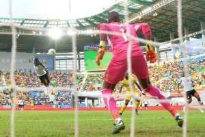 Ghana's Asamoah Gyan (L) scores a header during their 2017 Africa Cup of Nations Group D against Mali, in Port-Gentil, on January 21, 2017