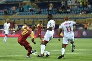 Ghana's midfielder Andre Ayew (L) shoots to score during the Africa Cup of Nations (CAN) football match between Ghana and Benin.  By OZAN KOSE (AFP)