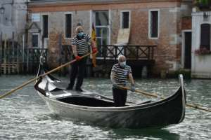 Gondoliers returned to the canals of Venice, even if they are now wearing masks and gloves.  By ANDREA PATTARO (AFP)