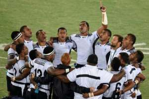 Golden days: Fiji players pray after winning the gold in Rio in 2016.  By PHILIPPE LOPEZ (AFP/File)