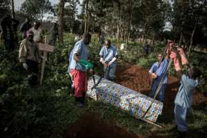 Gloved health workers conduct the burials and keep the loved ones at a safe distance. By JOHN WESSELS (AFP)
