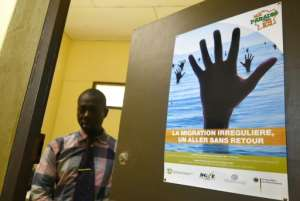 Grassroots groups in Daloa are trying to spread the message about the dangers of the migration trail -- the poster reads 'Clandestine emigration: a one-way ticket with no return'.  By Sia KAMBOU (AFP)