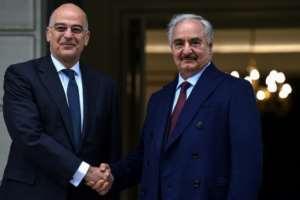Greek Foreign Minister Nikos Dendias (left) welcomed Libyan strongman Khalifa Haftar to Athens.  By Aris MESSINIS (AFP)