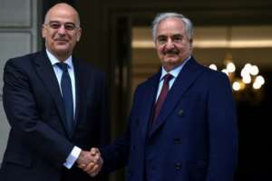 Greek Foreign Minister Nikos Dendias (left) welcomed Libyan strongman Khalifa Haftar to Athens.  By Aris MESSINIS (AFP)