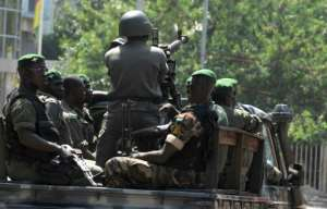 Guinean soldiers, similar to these pictured in 2010, opened fire ona  group of men leaving a house in Conakry, killing two of them.  By ISSOUF SANOGO (AFP/File)