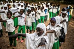 Hands on: Students queue before lessons at Wuro Fulbe Nomadic School in the Kacha Grazing Reserve, a zone set aside for pastoralists. Classrooms are almost bare of equipment and chronically overcrowded.  By Luis TATO (AFP)