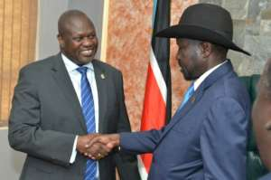 Handshake: President Salva Kiir, right, and ex-vice president and former rebel leader Riek Machar at their meeting on Wednesday.  By AKUOT CHOL (AFP)