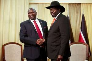 Handshake: President Salva Kiir (right) and his former vice president and rival, Riek Machar, pictured in Juba last October. The pair have until February 22 to form a coalition government scheduled under their 2018 peace accord..  By Alex McBride (AFP)