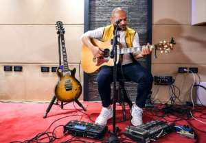 Hani El Dakkak, lead singer and guitarist for Egyptian rock band Massar Egbari, warms up in a recording studio in Cairo. By Mohamed el-Shahed (AFP)