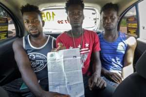 Haitian migrants waiting in Tapachula, Mexico show a document with information on their legal situation on June 26, 2019.  By Kenya YASBED (AFP/File)