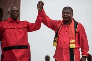 Happier times: Dos Santos and Lourenco, his hand-picked successor, at a rally in Luanda in August 2017.  By MARCO LONGARI (AFP)