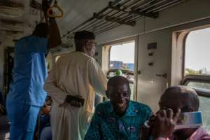 Happy: Passengers on the first train connecting Accra to Tema since the line was closed after a derailment in 2017. By RUTH MCDOWALL (AFP)