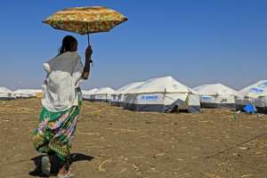 Haven: A woman who fled the Tigray conflict, pictured at the Tenedba refugee camp in Mafaza, eastern Sudan.  By ASHRAF SHAZLY (AFP)