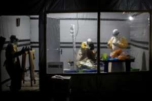 Health workers treat a possible Ebola patient inside a Doctors Without Borders-supported Ebola Treatment Center in east Democratic Republic of Congo, where the aid organization has partly suspended non-essential work after gunmen abducted two staff.  By John WESSELS (AFP/File)