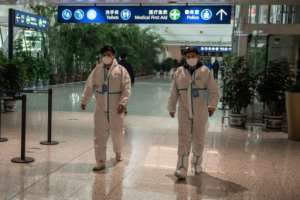Health workers were waiting to meet the WHO team as they arrived in Wuhan on Thursday ahead of their probe into the origins of the pandemic.  By NICOLAS ASFOURI (AFP)