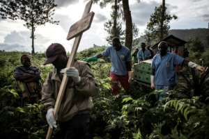 Health workers carry a coffin containing a victim of Ebola in Butembo, a city at the heart of the latest outbreak of the disease.  By JOHN WESSELS (AFP)