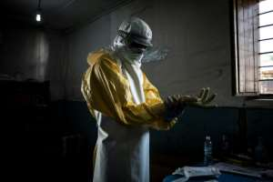 Health workers have to follow rigorous protection procedures against Ebola.  By John WESSELS (AFP/File)