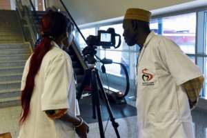 Health workers set up a thermal scanner to screen arriving passengers at Dakar's international airport.  By Seyllou (AFP)