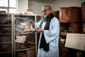 High school headmaster Mouhamedou Ahmadou set up a group to preserve Tichitt's historic manuscripts about 20 years ago but has few resources.  By JOHN WESSELS (AFP)