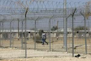 Holot detention centre is set to be shut down on April 1 as part of the Israeli government's policy to expel thousands of Eritreans and Sudanese who entered illegally.  By MENAHEM KAHANA (AFP)