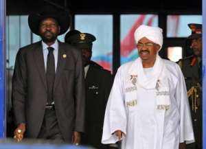 Omar al-Bashir (R) greets Salva Kiir upon the latter's arrival in Khartoum, in 2011.  By Ebrahim Hamid (AFP/File)