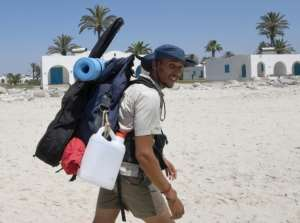 Houij hopes his two-month trek will help convince authorities, holidaymakers and average Tunisians that the sea should not be used as a giant garbage tip.  By FETHI BELAID (AFP)