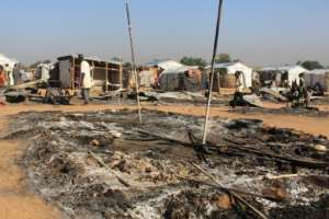 Houses have been left burnt by Boko Haram attacks.  By AUDU MARTE (AFP)
