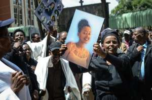 Hundreds gathered for the funerals at Holy Trinity Cathedral in Addis Ababa, weeping and holding up pictures of those who died. By Samuel HABTAB (AFP)