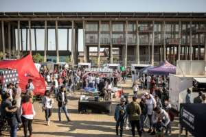 Hundreds of people attend the Kota Sandwich Festival in Soweto, the cradle of the South Africa's anti-apartheid movement.  By GIANLUIGI GUERCIA (AFP)