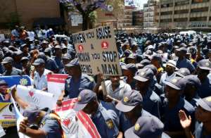 Hundreds of police joined the protest movement.  By Phill Magakoe (AFP/File)