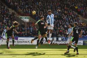 Huddersfield Town's Beninese striker Steve Mounie outjumped the Bournemouth defence to head his team's second goal