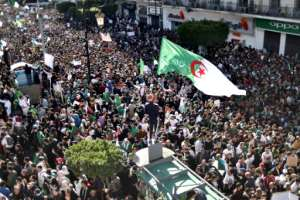 Huge crowds marched through the Algerian capital for a fourth consecutive on March 15 calling for Bouteflika's resignation. By RYAD KRAMDI (AFP)