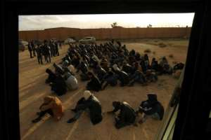 Illegal migrants are gathered in the Libyan city of Benghazi, before being repatriated, in January 2018.  By Abdullah DOMA (AFP/File)
