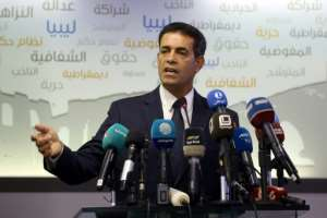 Imed al-Sayeh, head of Libya's electoral commission, speaks during a press conference in the capital Tripoli on December 6, 2018.  By Mahmud TURKIA (AFP)