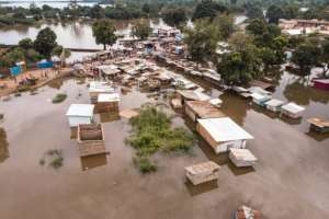 In the capital Bangui, with a population of about one million, mud homes have literally dissolved in the floods.  By FLORENT VERGNES (AFP)