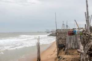 In the beachfront village of Agebkope on Togo's shore, houses have been swept into the sea and others teeter on the brink as coastal erosion worsens.  By YANICK FOLLY (AFP)