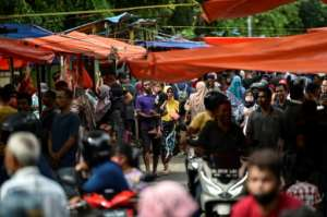 In the world's most populous Muslim country, Indonesia, people were scrambling to get around the rules to celebrate Eid al-Fitr.  By CHAIDEER MAHYUDDIN (AFP)