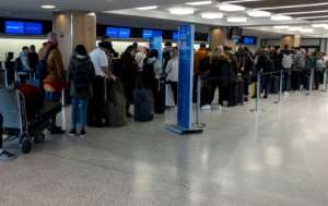 In the US, passengers complained of massive queues as staff battled with new entry rules and stipulations on medical screening.  By Johannes EISELE (AFP)