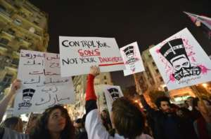 In this file photo from 2013 protesters hold up placards and shout slogans during a demonstration against sexual harassment in Egypt's capital Cairo.  By Khaled DESOUKI (AFP/File)