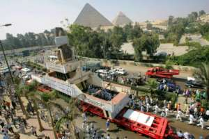 In this 2006 file photo, the massive statue of Ramses II, a 100-tonne, 11-meter-high pink granite colossus, is paraded in Giza as it ends its journey from Cairo to a spot near the Pyramids.  By Khaled DESOUKI (AFP/File)