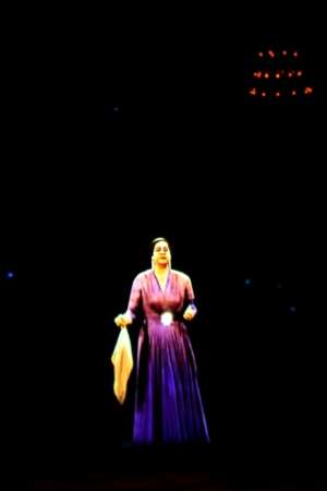 In a nod to her packed concerts of decades ago, the hologram was clad in a bright purple dress and clasped Umm Kulthum's signature handkerchief.  By Khaled DESOUKI (AFP)